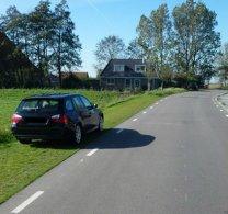 Infrastructure dynamique par l'utilisation de surfaces herbeuses renforcées pour le stationnement.